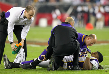 GLENDALE, AZ - DECEMBER 06:  Linebacker E.J. Henderson #56 of the Minnesota Vikings is looked at by trainers after being injured during the NFL game against the Arizona Cardinals at the Universtity of Phoenix Stadium on December 6, 2009 in Glendale, Arizo
