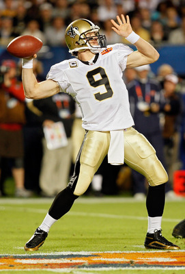 MIAMI GARDENS, FL - FEBRUARY 07:  Quarterback Drew Brees #9 of the New Orleans Saints passes against the Indianapolis Colts during Super Bowl XLIV on February 7, 2010 at Sun Life Stadium in Miami Gardens, Florida.  (Photo by Andy Lyons/Getty Images)