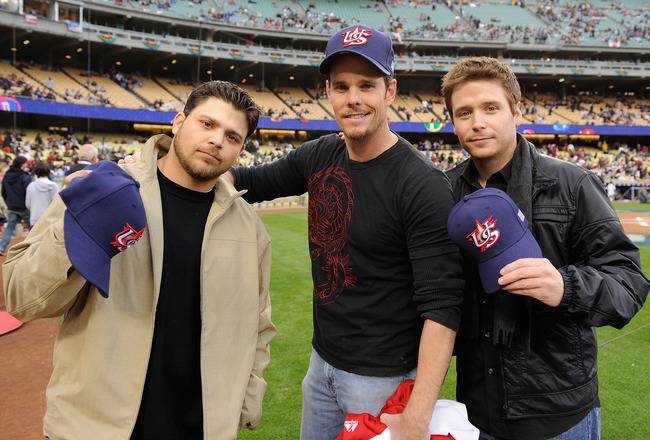 LOS ANGELES - MARCH 22: (L-R) Actors Jerry Ferrara, Kevin Dillon and Kevin Connolly pose with hats the United States baseball team before the semifinal game of the 2009 World Baseball Classic against Japan on March 22, 2009 at Dodger Stadium in Los Angele