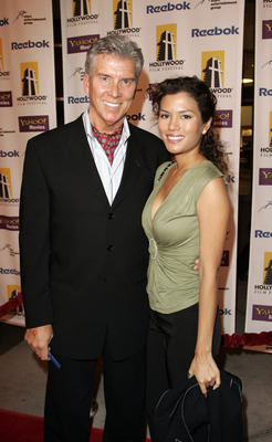 LOS ANGELES - OCTOBER 20:  Sports personality Michael Buffer (L) and Christine Prado arrive at the Hollywood Film Festival presentation of 'Bullets Over Hollywood' at the Arclight Theatre October 20, 2005 in Los Angeles, California.  (Photo by Michael Buc