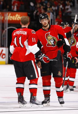 OTTAWA, ON - APRIL 24:  Jason Spezza #19 and Daniel Alfredsson #11 of the Ottawa Senators talk during a break in action against the Pittsburgh Penguins in Game 6 of the Eastern Conference Quaterfinals of the 2010 Stanley Cup Playoffs at Scotiabank Place o