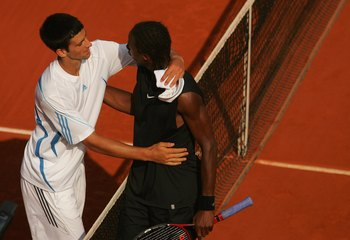PARIS - JUNE 05:  Novak Djokovic (L) of Serbia and Montenegro hugs Gael Monfils of France during day nine of the French Open at Roland Garros on June 5, 2006 in Paris, France.  (Photo by Matthew Stockman/Getty Images)