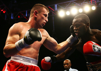 NEWARK, NJ - DECEMBER 11:  Tomasz Adamek punches Steve Cunningham  during their IBF Cruiserweight Championship fight on December 11, 2008 at The Prudential Center in Newark, New Jersey.  Tomask won a split decision.  (Photo by Al Bello/Getty Images)