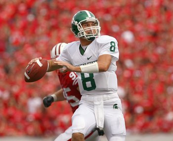 MADISON, WI - SEPTEMBER 26: Kirk Cousins #8 of the Michigan State Spartans looks to pass the ball against the Wisconsin Badgers on September 26, 2009 at Camp Randall Stadium in Madison, Wisconsin. (Photo by Jonathan Daniel/Getty Images)