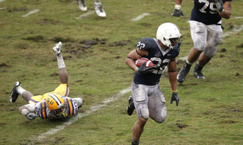 ORLANDO, FL - JANUARY 1: Evan Royster #22 of the Penn State Nittany Lions runs with the football during the 2010 Capital One Bowl against the LSU Tigers at the Florida Citrus Bowl Stadium on January 1, 2010 in Orlando, Florida. Penn State won 19-17. (Phot