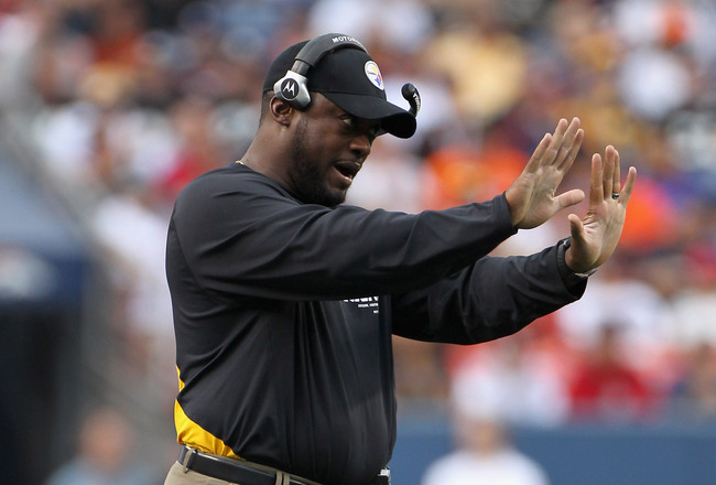 DENVER - AUGUST 29:  Head coach Mike Tomlin of the Pittsburgh Steelers leads his team against the Denver Broncos during preseason NFL action at INVESCO Field at Mile High on August 29, 2010 in Denver, Colorado. The Broncos defeated the Steelers 34-17.  (P