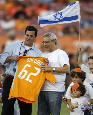 HOUSTON - SEPTEMBER 05:  Houston Dynamo COO Chris Canetti (L) presents Consul General of Israel Meir Shlomo a Houston Dynamo Jersey on Jewish Community Night at Robertson Stadium  on September 5, 2010 in Houston, Texas.  (Photo by Bob Levey/Getty Images)