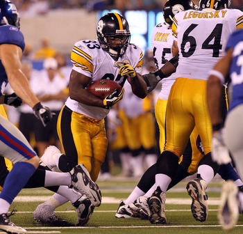 EAST RUTHERFORD, NJ - AUGUST 21:  Isaac Redman #33 of the Pittsburgh Steelers rushes in for a touchdown against the New York Giants during their preseason game at New Meadowlands Stadium on August 21, 2010 in East Rutherford, New Jersey.  (Photo by Nick L