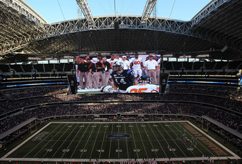 ARLINGTON, TX - SEPTEMBER 04:  Quarterback Andy Dalton #14 of the TCU Horned Frogs is shown on the video screen during play against the Oregon State Beavers at Cowboys Stadium on September 4, 2010 in Arlington, Texas.  (Photo by Ronald Martinez/Getty Imag