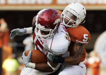 AUSTIN, TX - SEPTEMBER 27:  Safety Ben Wells #5 of the Texas Longhorns wrestles tight end D.J. Williams #45 of the Arkansas Razorbacks in the fourth quarter on September 27, 2008 at Darrell K Royal-Texas Memorial Stadium in Austin, Texas.  Texas won 52-10