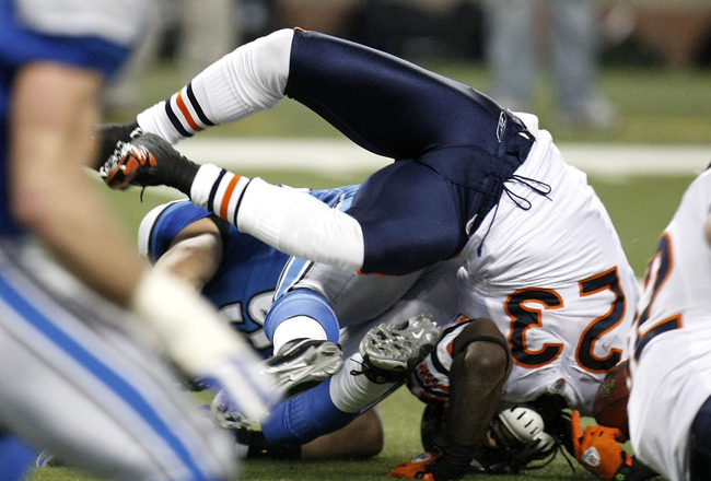 DETROIT - JANUARY 03:  Devin Hester #23 of the Chicago Bears is flipped over during a kick return while playing the Detroit Lions on January 3, 2010 at Ford Field in Detroit, Michigan. Chicago won the game 37-23.  (Photo by Gregory Shamus/Getty Images)