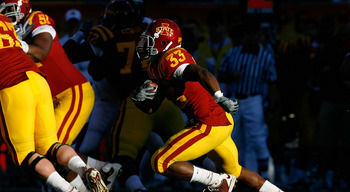 TEMPE, AZ - DECEMBER 31:  Runningback Alexander Robinson #33 of the Iowa State Cyclones rushes the football against the Minnesota Golden Gophers during the Insight Bowl at Arizona Stadium on December 31, 2009 in Tempe, Arizona. The Cyclones defeated the G