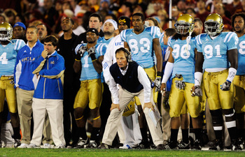 LOS ANGELES, CA - NOVEMBER 28:  Head coach Rick Neuheisel of the UCLA Bruins follows the action from the sideline against USC Trojans during the first quarter of the NCAA college football game at Los Angeles Memorial Coliseum on November 28, 2009 in Los A