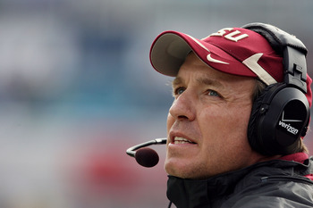 JACKSONVILLE, FL - JANUARY 01:  Offensive coordinator and future head coach Jimbo Fisher of the Florida State Seminoles walks the sidelines while taking on the West Virginia Mountaineers during the Konica Minolta Gator Bowl on January 1, 2010 at Jacksonvi