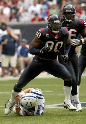 HOUSTON - OCTOBER 05:  Defensive end Mario Williams #90 of the Houston Texans celebrates after sacking quarterback Peyton Manning #18 of the Indianapolis Colts on October 5, 2008 at Reliant Stadium in Houston, Texas.  The Colts won 31-27. (Photo by Stephe