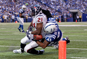 INDIANAPOLIS - NOVEMBER 08:  Antoine Bethea #41 of the Indianapolis Colts causes a fumble as he tackles Ryan Moats #21 of the Houston Texans during the NFL game at Lucas Oil Stadium on November 8, 2009 in Indianapolis, Indiana. The Colts won 20-17.  (Phot