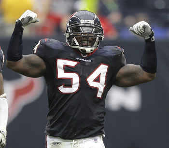 HOUSTON - DECEMBER 13:  Linebacker Zac Diles #54 of the Houston Texans celebrate after a defensive stop against the Seattle Seahawks at Reliant Stadium on December 13, 2009 in Houston, Texas. The Texans won 34-7. (Photo by Bob Levey/Getty Images)