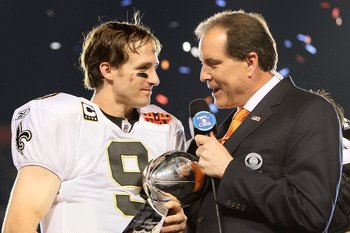 MIAMI GARDENS, FL - FEBRUARY 07:  Quarterback Drew Brees #9 of the New Orleans Saints is interviewed by CBS announcer Jim Nantz after the Saints defeated the Indianapolis Colts during Super Bowl XLIV on February 7, 2010 at Sun Life Stadium in Miami Garden