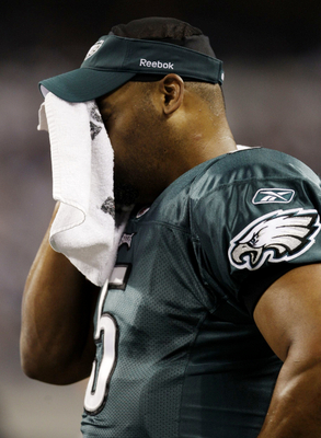 ARLINGTON, TX - JANUARY 9:  Quarterback Donovan McNabb #5 of the Philadelphia Eagles wipes his face from the sideline in the second quarter against the Dallas Cowboys during the 2010 NFC wild-card playoff game at Cowboys Stadium on January 9, 2010 in Arli