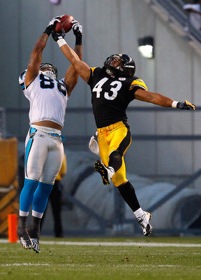 PITTSBURGH - SEPTEMBER 02:  Dante Rosario #88 of the Carolina Panthers catches a pass in front of Troy Polamalu #43 of the Pittsburgh Steelers during the preseason game on September 2, 2010 at Heinz Field in Pittsburgh, Pennsylvania.  (Photo by Jared Wick