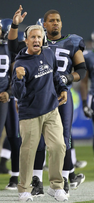 SEATTLE - AUGUST 21:  Head coach Pete Carroll of the Seattle Seahawks and Sean Locklear #75 react after the Seahawks scored a touchdown during the preseason game against the Green Bay Packers at Qwest Field on August 21, 2010 in Seattle, Washington. (Phot