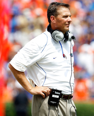 GAINESVILLE, FL - SEPTEMBER 04:  Head coach Urban Meyer of the Florida Gators watches the action against the Miami University RedHawks at Ben Hill Griffin Stadium on September 4, 2010 in Gainesville, Florida.  (Photo by Sam Greenwood/Getty Images)