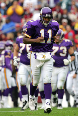 LANDOVER, MD - JANUARY 2:  Quarterback Duante Culpepper #11 of the Minnesota Vikings hangs his head during the first half of the game against the Washington Redskins at FedEx Field on January 2, 2005 in Landover, Maryland.  (Photo by Jamie Squire/Getty Im