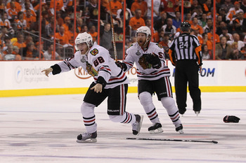PHILADELPHIA - JUNE 09:  Patrick Kane #88 of the Chicago Blackhawks celebrates with teammate Brian Campbell #51 after scoring the game-winning goal in overtime to defeat the Philadelphia Flyers 4-3 and win the Stanley Cup in Game Six of the 2010 NHL Stanl