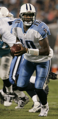 CHARLOTTE, NC -AUGUST 28:  Quarterback Vince Young #10 of the Tennessee Titans looks for his running back during their preseason game against the Carolina Panthers at Bank of America Stadium on August 28, 2010 in Charlotte, North Carolina. (Photo by Mary