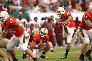 MIAMI - OCTOBER 04:  Place kicker Matt Bosher #25 of the Miami Hurricanes follows his field goal attmept out from under the hold of Matt Perrelli #19 while taking on the Florida State Seminoles at Dolphin Stadium on October 4, 2008 in Miami, Florida. Flor