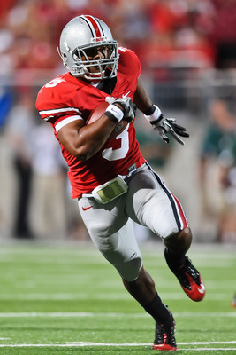 COLUMBUS, OH - SEPTEMBER 2: Brandon Saine #3 of the Ohio State Buckeyes runs with the ball against the Marshall Thundering Herd at Ohio Stadium on September 2, 2010 in Columbus, Ohio. (Photo by Jamie Sabau/Getty Images)