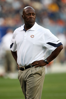 CHICAGO - AUGUST 21: Head coach Lovie Smith of the Chicago Bears watches as his team enters the field for warm-ups before taking on the Oakland Raiders during a preseason game at Soldier Field on August 21, 2010 in Chicago, Illinois. The Raiders defeated