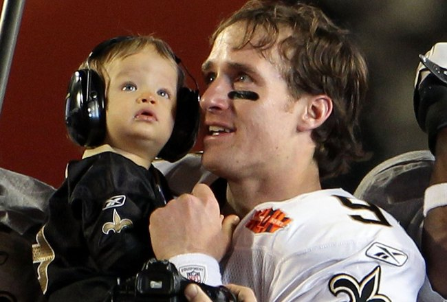 MIAMI GARDENS, FL - FEBRUARY 07:  Drew Brees #9 of the New Orleans Saints holds his son Baylen Brees to celebrate after the Saints defeated the Indianapolis Colts during Super Bowl XLIV on February 7, 2010 at Sun Life Stadium in Miami Gardens, Florida.  (