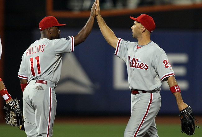 NEW YORK - AUGUST 14:  Jimmy Rollins #11 and Raul Ibanez #29 of the Philadelphia Phillies celebrate after defeating the New York Mets on August 14, 2010 at Citi Field in the Flushing neighborhood of the Queens borough of New York City. The Phillies defeat