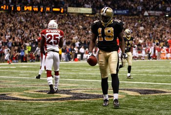 NEW ORLEANS - JANUARY 16:  Devery Henderson #19 of the New Orleans Saints reacts after he scored on a 44-yard touchdown reception in the second quarter against Bryant McFadden #25 of the Arizona Cardinals during the NFC Divisional Playoff Game at Louisana