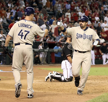 PHOENIX - AUGUST 07:  Adrian Gonzalez #23 of the San Diego Padres celebrates with teammate Ryan Ludwick #47 after Gonzalez hit a solo home run against the Arizona Diamondbacks during the ninth inning of the Major League Baseball game at Chase Field on Aug
