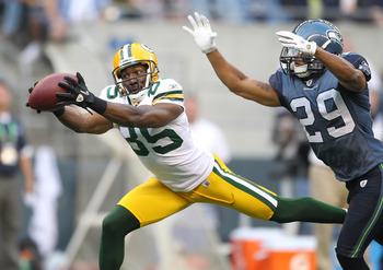 SEATTLE - AUGUST 21:  Wide receiver Greg Jennings #85 of the Green Bay Packers makes a catch during the preseason game against Earl Thomas #29 of the Seattle Seahawks at Qwest Field on August 21, 2010 in Seattle, Washington. (Photo by Otto Greule Jr/Getty