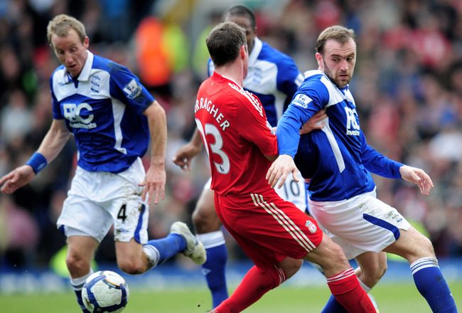BIRMINGHAM, ENGLAND - APRIL 04:  James McFadden of Birmingham City is challenged by Jamie Carragher of Liverpool during the Barclays Premier League match between Birmingham City and Liverpool at St. Andrews Stadium on April 4, 2010 in Birmingham, England.