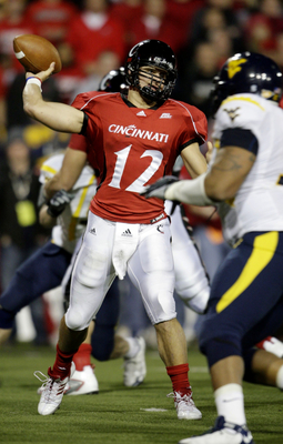 CINCINNATI - NOVEMBER 13: Quarterback Zach Collaros #12 of the the Cincinnati Bearcats passes the ball in the second quarter of the game against the West Virginia Mountaineers at Nippert Stadium on November 13, 2009 in Cincinnati, Ohio.  (Photo by Andy Ly