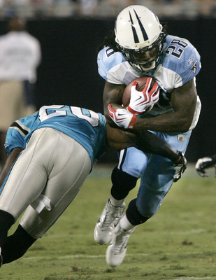 CHARLOTTE, NC - AUGUST 28:  Runningback Chris Johnson #28 of the Tennessee Titans is tackled by Chris Gamble #20 of the Carolina Panthers during their preseason game at Bank of America Stadium on August 28, 2010 in Charlotte, North Carolina. (Photo by Mar