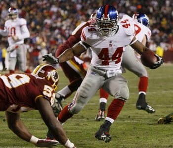 LANDOVER, MD - DECEMBER 21:  Running back Ahmad Bradshaw #44 of the New York Giants rushes four yards for a touchdown against the Washington Redskins at FedEx Field on December 21, 2009 in Landover, Maryland. (Photo by Win McNamee/Getty Images)