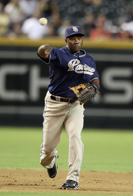 PHOENIX - AUGUST 30:  Infielder Miguel Tejada #10 of the San Diego Padres fields a ground ball out during the Major League Baseball game against the Arizona Diamondbacks at Chase Field on August 30, 2010 in Phoenix, Arizona. The Diamondbacks defeated the