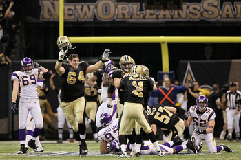 NEW ORLEANS - JANUARY 24:  Kicker Garrett Hartley #5 of the New Orleans Saints celebrates with teammates David Thomas #85, Zach Strief #64 and Mark Brunell #11 after kicking a 40-yard game-winning field goal in overtime against the Minnesota Vikings durin
