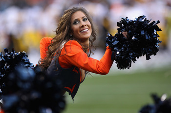 DENVER - AUGUST 29:  A member of the Denver Broncos cheerleading squad performs during a break in the action against the Pittsburgh Steelers during preseason NFL action at INVESCO Field at Mile High on August 29, 2010 in Denver, Colorado. The Broncos defe