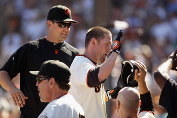 SAN FRANCISCO - AUGUST 25:  Aubrey Huff #17 of the San Francisco Giants is congratulated by teaemmates after he hit a sac fly that scored Andres Torres to put the Giants ahead 11-10 in the eighth inning of their game against the Cincinnati Reds at AT&T Pa