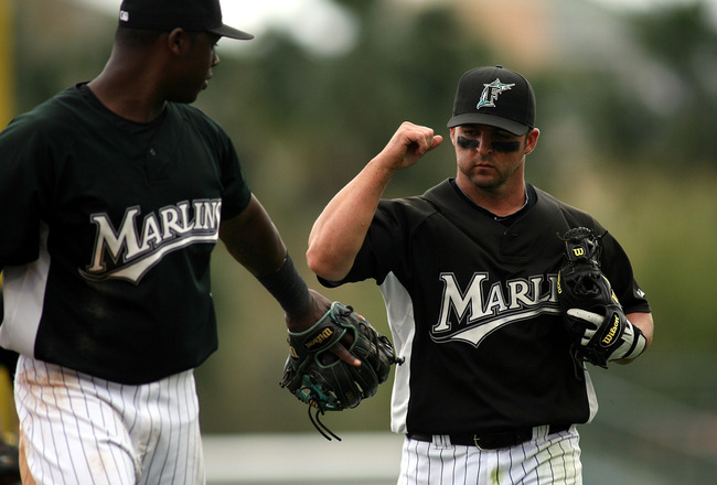 JUPITER, FL - MARCH 28:  Hanley Ramirez #2 and Dan Uggla #6 of the Florida Marlins come off the field  against the Houston Astros on March 28, 2010 at Roger Dean Stadium in Jupiter, Florida.  (Photo by Marc Serota/Getty Images)