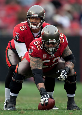 TAMPA, FL - JANUARY 03:  Center Jeff Faine #52 prepares to snap the ball to quarterback Josh Freeman #5 of the Tampa Bay Buccaneers during the game against the Atlanta Falcons at Raymond James Stadium on January 3, 2010 in Tampa, Florida.  (Photo by J. Me