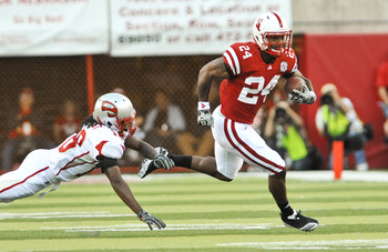 LINCOLN, NE - SEPTEMBER 04:  Jamal Forest #18 of the Western Kentucky Hilltoppers  tries to bring down Niles Paul #24 of the Nebraska Cornhuskers during first half action of their game at Memorial Stadium on September 4, 2010 in Lincoln, Nebraska.  Nebras