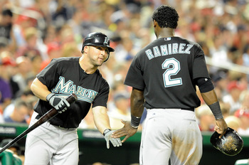 WASHINGTON - AUGUST 10:  Hanley Ramirez #2 of the Florida Marlins is congratulated by Dan Uggla #6 after scoring in the fifth inning against the Washington Nationals at Nationals Park on August 10, 2010 in Washington, DC.  (Photo by Greg Fiume/Getty Image
