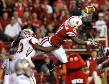 LINCOLN, NE - SEPTEMBER 04:  Prince Amukamara #21 of the Nebraska Cornhuskers knocks down a pass intended for Tristan Jones #33 of the Western Kentucky Hilltoppers during second half action of their game against at Memorial Stadium on September 4, 2010 in